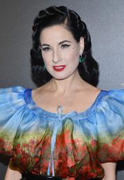Dita Von Teese styled her hair into a crown braid with curly ends for the Irving Penn exhibition.