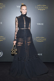 Natasha Poly was a perfect blend of sexy and goth in this sheer black lace-panel gown by Elie Saab at the Irving Penn exhibition.