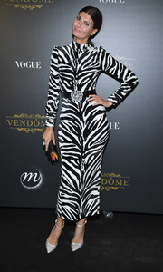 Giovanna Battaglia looked striking in a zebra-print pencil dress by Alessandra Rich at the Irving Penn exhibition.
