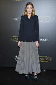 Olivia Palermo chose a pleated gray maxi skirt (also by Valentino) to complete her outfit.
