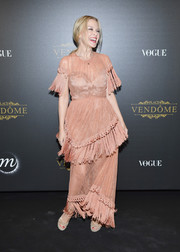 Kylie Minogue went for a vintage-glam vibe with this tasseled antique-rose gown by Alice McCall at the Irving Penn exhibition.