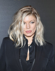 Fergie was sexily coiffed with teased waves at the Irving Penn exhibition.