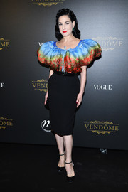 Dita Von Teese charmed in a Jean Paul Gaultier Couture poppy-print blouse with puffed sleeves at the Irving Penn exhibition.