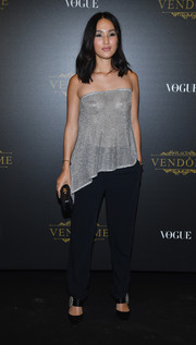 Nicole Warne looked party-ready in a silver tube top with an asymmetrical hem at the Irving Penn exhibition.