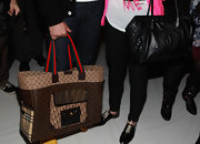 Robert Verdi showed off a tote bag with multiple high end designer monograms.