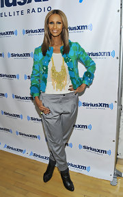 Iman was casual chic at the Sirius studios in NYC. She donned a bright print jacket paired with loose gray pants and black leather ankle boots.