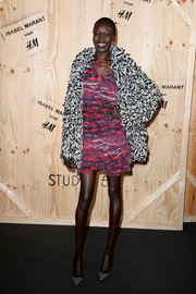 Alek Wek looked fun and chic in a thick black-and-white coat layered over a colorful dress during the Isabel Marant photocall.