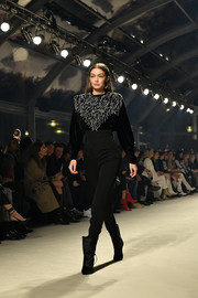 Gigi Hadid walked the Isabel Marant Fall 2020 show wearing an embellished black velvet top.