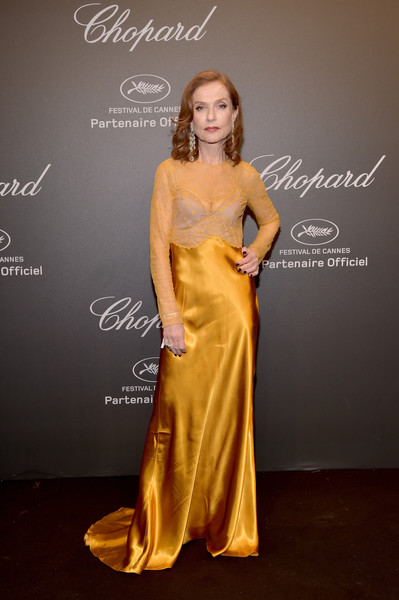 Isabelle Huppert Evening Dress [yellow,gown,fashion model,flooring,beauty,dress,shoulder,lady,fashion show,model,caroline scheufele,isabelle huppert,rihanna,chopard space party - photocall,cannes,france,port canto,chopard space party,chopard,cannes film festival]