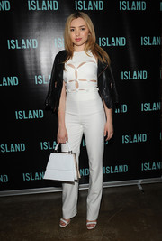 Peyton List layered a black leather jacket over her jumpsuit for an even chicer finish.