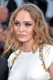 Lily-Rose Depp wore her hair in loose, messy-glam waves at the Cannes Film Festival opening gala.