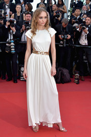 Lily-Rose Depp looked simply divine in a white Chanel cutout gown with gold trim at the Cannes Film Festival opening gala.