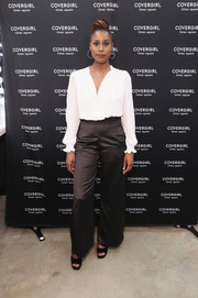 Issa Rae paired her blouse with black high-waisted pants.