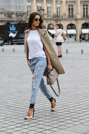 "Brazilian model Izabel Goulart looked so stunning prancing nonchalantly along Place Vendome in Paris that she brought new meaning to the phrase ""tearing it up"" with her stylishly shredded jeans."