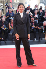 Alessandra Mastronardi went menswear-chic in a black pantsuit at the Venice Film Festival screening of 'J'Accuse.'