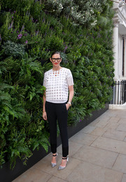 Jenna Lyons chose a pair of black slim-fit slacks to team with her top.