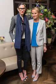 Jenna Lyons spiffed up her blazer and leather pants combo with a patterned blue scarf for the J. Crew photocall.
