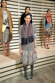 Jenna Lyons looked fun and chic in a gray dress with feathers on the skirt during the J. Crew presentation.