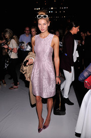 Jessica Hart kept the girly motif going all the way down to her metallic pink pointy pumps.