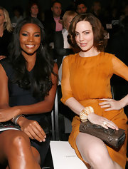 Melissa sat front row at the J. Mendel Spring 2011 Fashion Show wearing a fossilized sunburst walrus ivory ring.