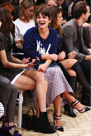 Pixie Geldof stepped out in a lovely pair of pink and black cap-toe pumps during the J.W. Anderson fashion show.