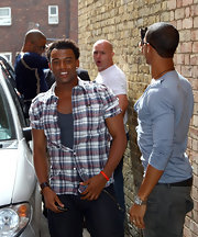Unbuttoned down-to-there and with sleeves rolled up, Oritse Williams' checkered button-down had a summer vibe.