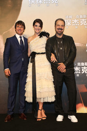 Cobie Smulders went frilly and elegant in a monochrome Marc Jacobs one-shoulder dress, rendered entirely in tiered ruffles, for the 'Jack Reacher' Shanghai fan signing.