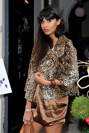 Jameela threw a chic animal print fur coat over her short silk dress for a night out in London.