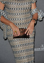 Simona Ventura finished off her chic ensemble with a metallic gold Ferragamo clutch.