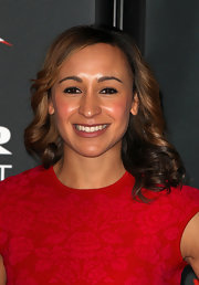 Wearing spiral curls and a red cocktail dress, Jessica Ennis looked very ladylike at the Jaguar Academy of Sports Awards.