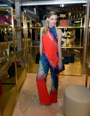 Jaime King wears a colorful printed jumpsuit at the MCM Las Vegas store opening