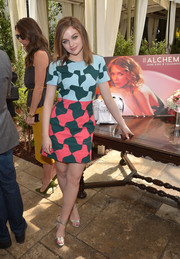 Joey King dressed up her look with a pair of gold evening sandals by Via Spiga.