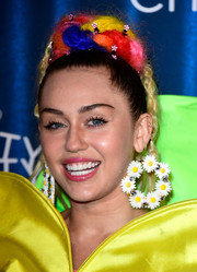 Miley Cyrus added more pizzazz with a pair of oversized flower hoops by Gasoline Glamour.
