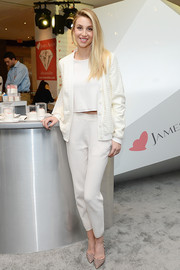Whitney Port was sporty in a textured white cardigan layered over a crop-top at the JamesAllen.com Diamond Day event.