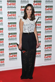 Jenna Louise Coleman chose a black and white lace evening gown with peak shoulders and a tread-on skirt for her look at the Empire Awards.