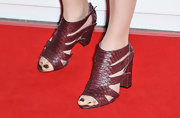 Jodie Whittaker chose a pair of cranberry, snakeskin sandals for her look at the Empire Awards in London.