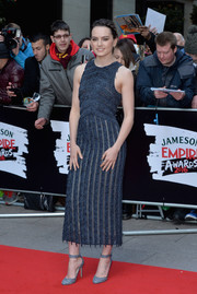 Daisy Ridley looked svelte and chic in a form-fitting blue fringe dress by Boss at the Jameson Empire Awards.