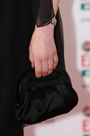 Gina took the safe route with a black satin evening bag while attending the Jameson Empire Film Awards.