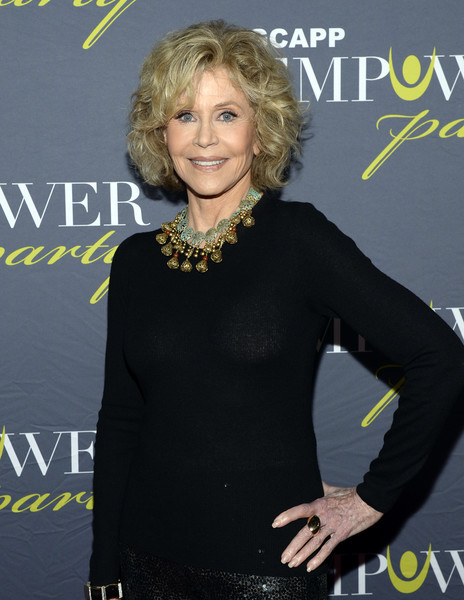 Jane Fonda jazzed up her black sweater with a gold chandelier necklace for the GCAPP EmPower Party.