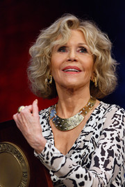 Jane Fonda showed off a stylish hammered gold necklace.
