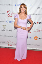 Jane Seymour kept it sweet and elegant in a fitted lilac column dress with rosette cap sleeves at the 2019 Open Hearts Gala.