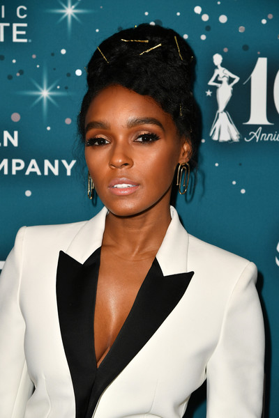 Janelle Monae Beehive [red carpet,hair,beauty,fashion model,hairstyle,fashion accessory,fashion,black hair,music artist,long hair,formal wear,honoree,janelle monae,essence black women in hollywood awards,essence black women in hollywood awards,beverly hills,california,beverly wilshire four seasons hotel]