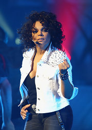 Janet Jackson performed in Sydney in a studded white denim jacket and a low-cut tank.