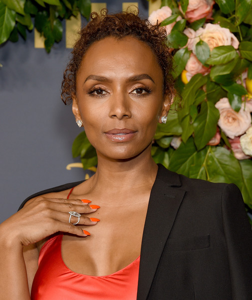 Janet Mock Curly Updo [hair,hairstyle,lip,beauty,forehead,smile,formal wear,black hair,ringlet,arrivals,janet mock,emmy,los angeles,california,walt disney television,party,walt disney television emmy party]