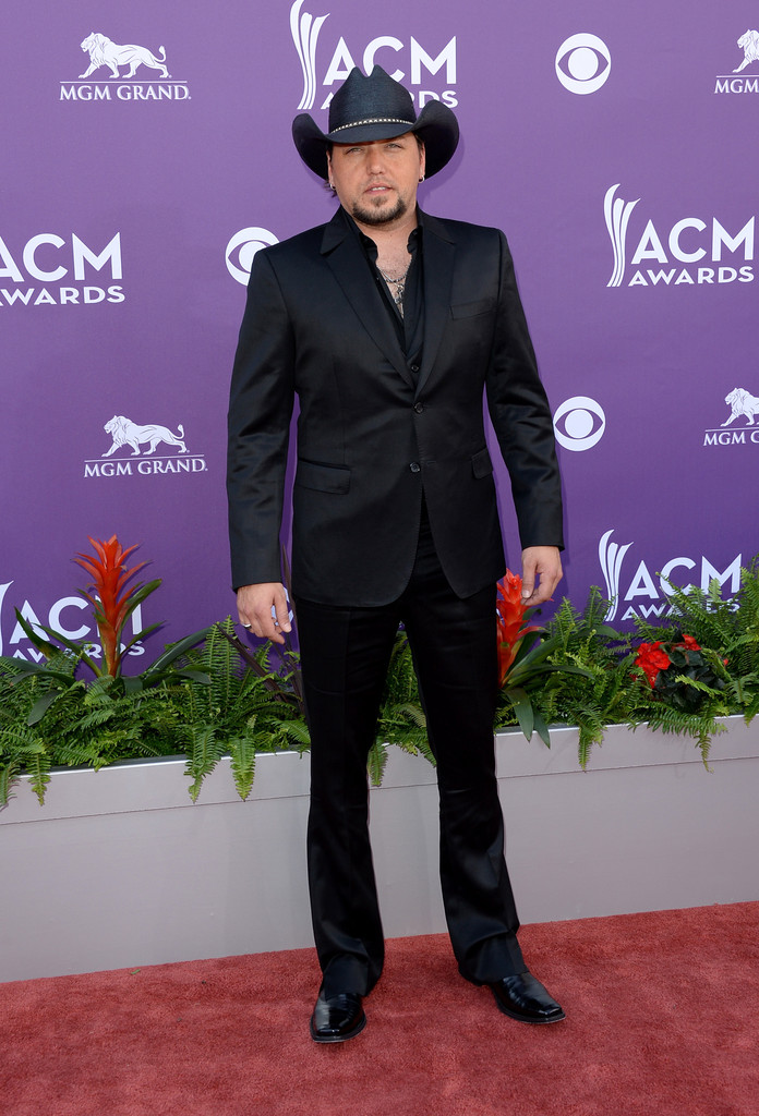 Jason Aldean chose a sleek contemporary suit for his monochromatic look at  the ACM Awards. 7e1bd10f6b0