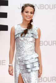 Alicia Vikander accessorized with a layered diamond bracelet to match her sequin dress at the European premiere of 'Jason Bourne.'