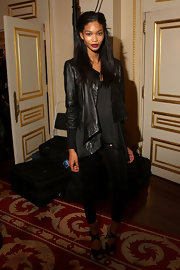 Chanel Iman topped off her tough-chic look with a draped black leather jacket.