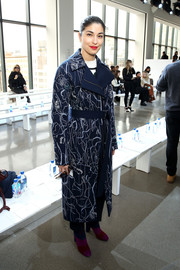 Caroline Issa attended the Jason Wu fashion show wearing a navy doodle-print coat from the label.