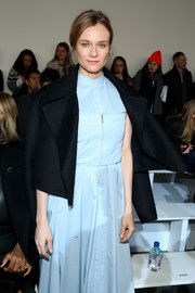 Diane Kruger arrived for the Jason Wu fashion show wearing a black cropped jacket over a pastel-blue dress.