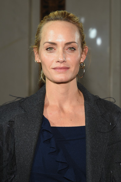 Amber Valletta pulled her hair back into a casual bun for the Jason Wu fashion show.